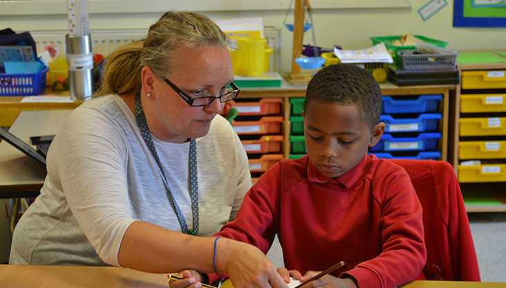 Laughton All Saints school teacher and pupil working in class